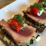 Seared Peppered Ahi Tuna with Wasabi Cream Cheese, Red Pimento & Wasabi Caviar on a Multi-Grain Toast